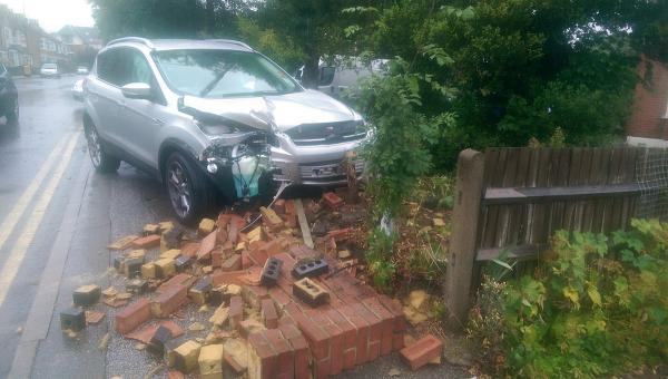 News Shopper: The Ford Kuga ended up in someone's front garden (image by Martin Peaple).