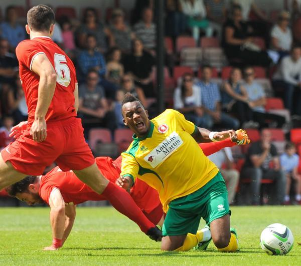 Malachi Hudson is fouled by Rhoys Wiggins for Welling's penalty. Picture by Dave Budden.