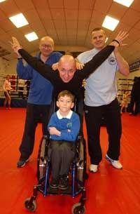 Shea with his sky-diving uncle John Gibbens, supporter Harold Barker and Gym owner Alan Keddle	BR2480-01