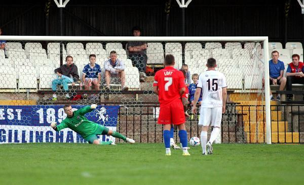 Danny Kedwell (hidden) beats Seb Brown from the spot to open the scoring