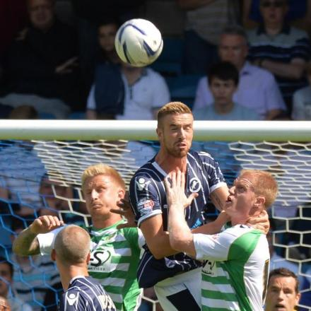 Defender Mark Beevers wins a header in last season's opening game against Yeovil. Picture by Keith Gillard..