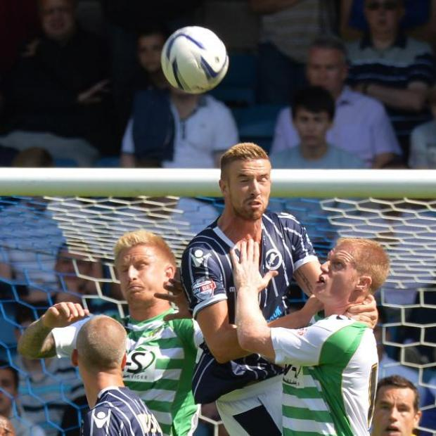 News Shopper: Defender Mark Beevers wins a header in last season's opening game against Yeovil. Picture by Keith Gillard..