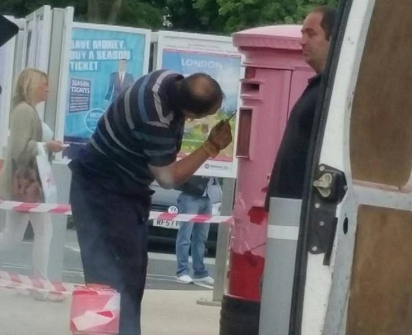 A man is spotted painting Dartford station post box pink (image from the Dartford Past, Present and Future Facebook group).