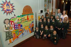 Pickhurst Junior School pupils admire their colourful work with Kenneth Colpus from the Hayes Kent Trust, teacher Sarah Bevan and Sue Rogers from the trust.	BR10832