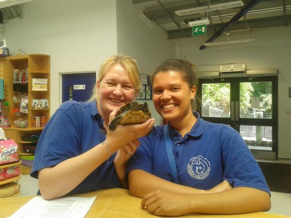 Rehoming and welfare assistants Jackie Macmaster (left) and Lara-Jane Gilling holding Terry the terrapin