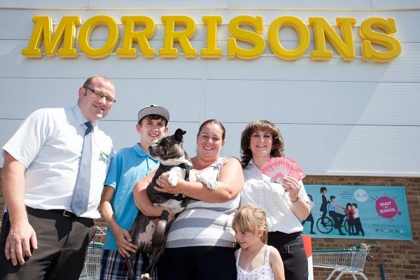 Left to right: store manager Richard Turvey, 38, Aston Stacey, 13, Ruby the dog, Sharon Stacey, 41, Elsie Stacey, 5, and Morrisons community champion Julie Devonport, 43.