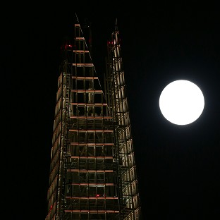 News Shopper: A view of the 'supermoon', or perigee moon, rising behind The Shard building in London.
