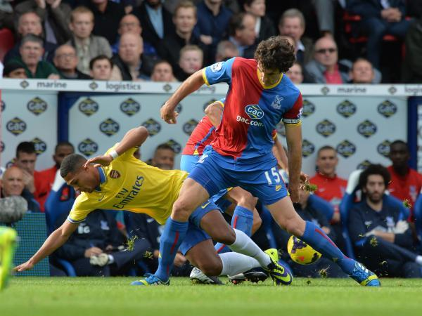Mile Jedinak in action against the Gunners at Selhurst Park last October. Picture by Keith Gillard.