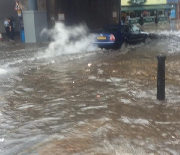 Heavy thunderstorm floods road in Lewisham