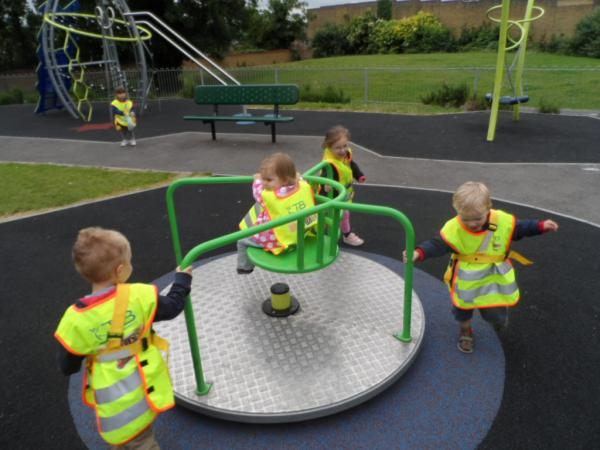 Nursery pupils make the most of outdoor play equipment.