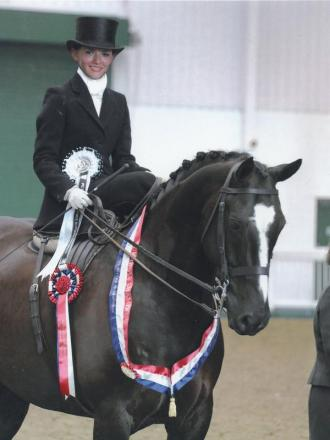 Victorious Morgan Schive with her horse Nightwatchman.