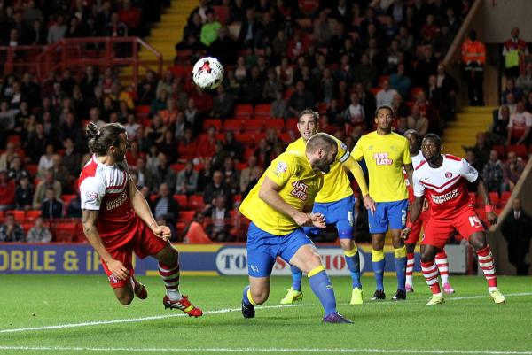 Lawrie Wilson flicks the ball on to set up Igor Vetokele's goal. Pictures by Edmund Boyden.
