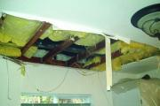 A burst pipe caused this ceiling to collapse while the house was left empty