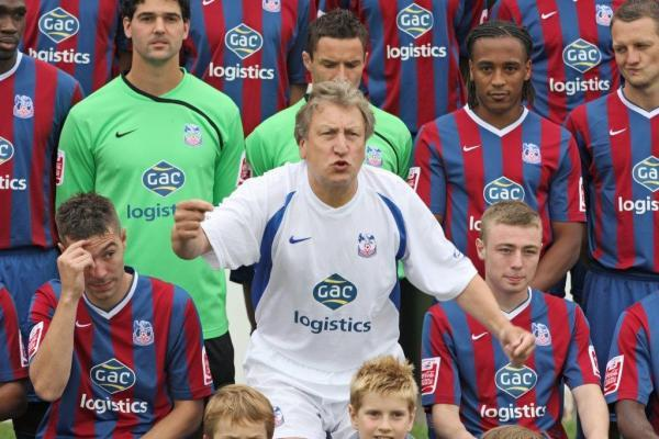Neil Warnock was very hands on during his previous spell at Palace - pictured here organising the 2009 team photo