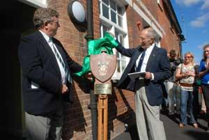 Alf Botterill, right,  unveils a plaque marking the opening of ERC's new headquarters in 2007.