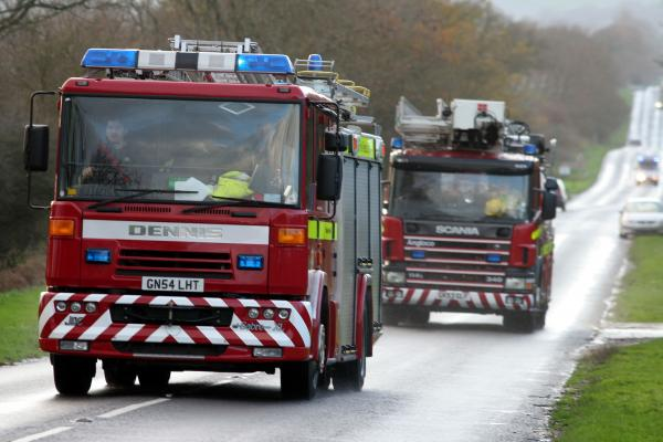 Fire crews battle large field fire in Longfield