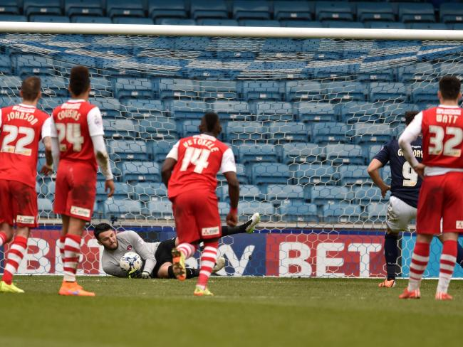 Stephen Henderson saves Lee Gregory's penalty at The Den. Picture by Keith Gillard.