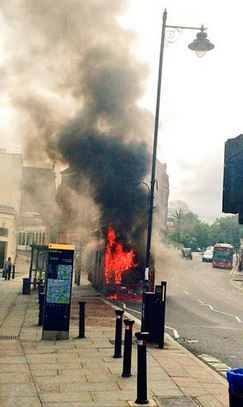 The bus in flames. Picture: Chris Holland
