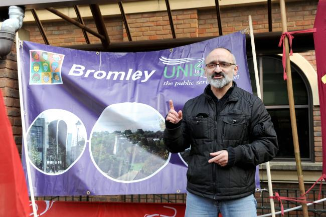 Unite regional officer Onay Kasab outside Bromley Council offices last year.