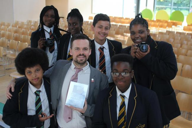 Teacher Dan Simpson with his media pupils
