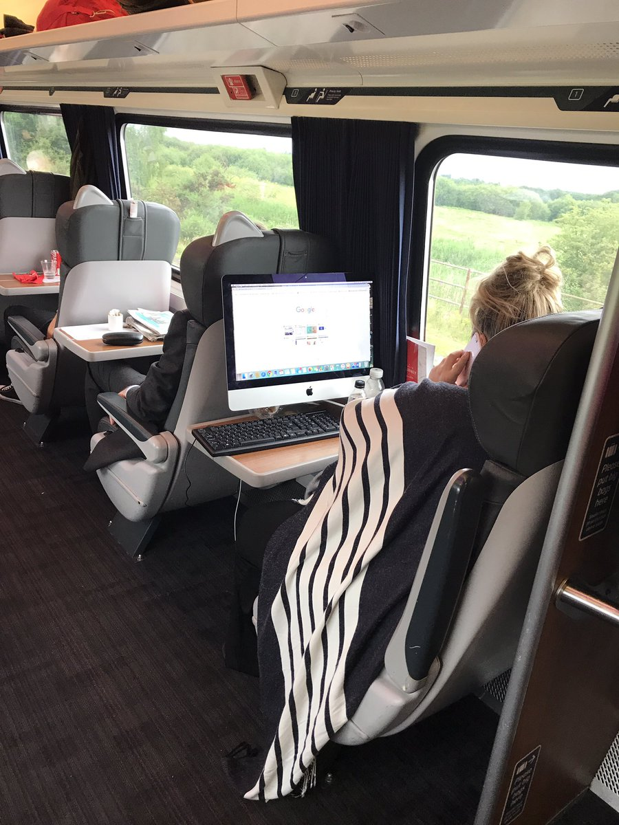 The woman pictured on the train with her desktop computer. Picture: David Hill via Twitter