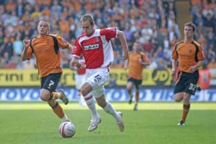 Luke Varney (above) gets clear of Wolves' Michael Kightly at The Valley