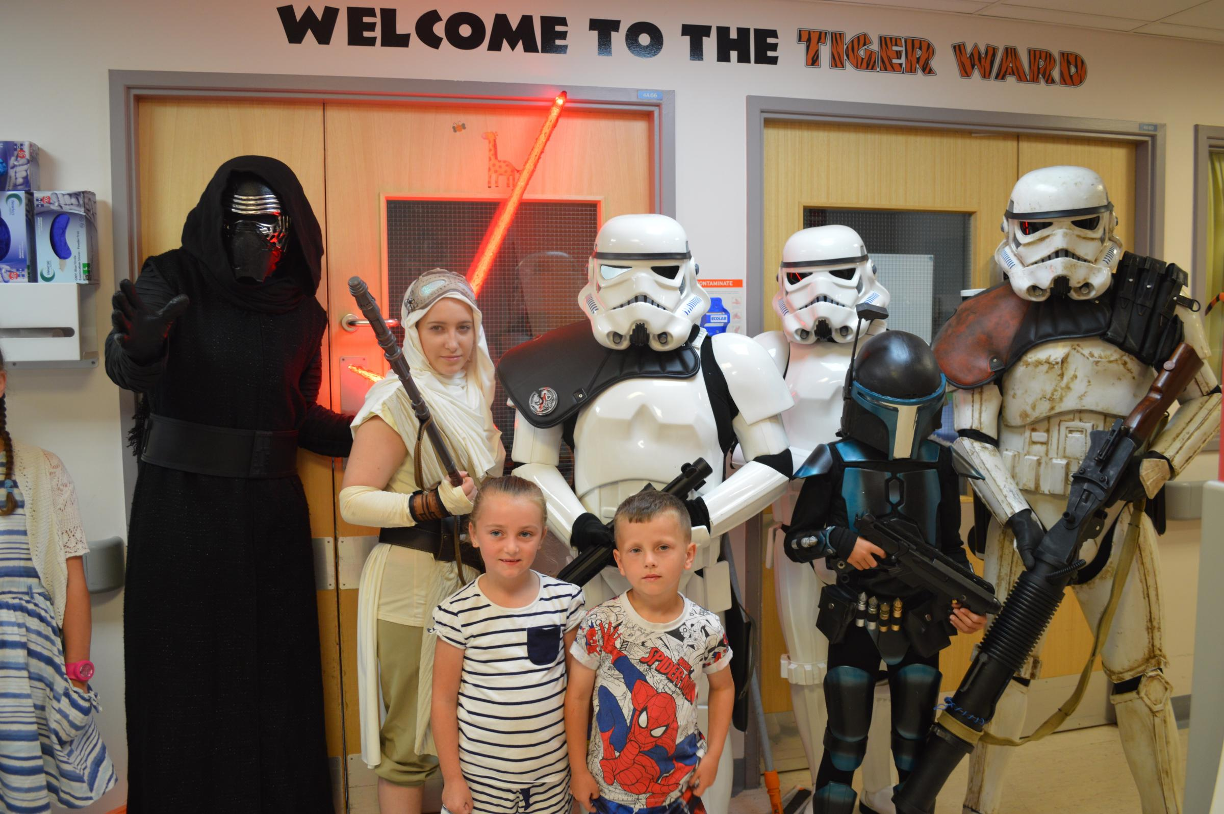 Travellors from a galaxy far far away visit children at Queen Elizabeth Hospital's cancer ward