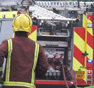 Crews battle Woolwich shop fire
