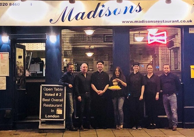 The Madison's team with an OMG burger