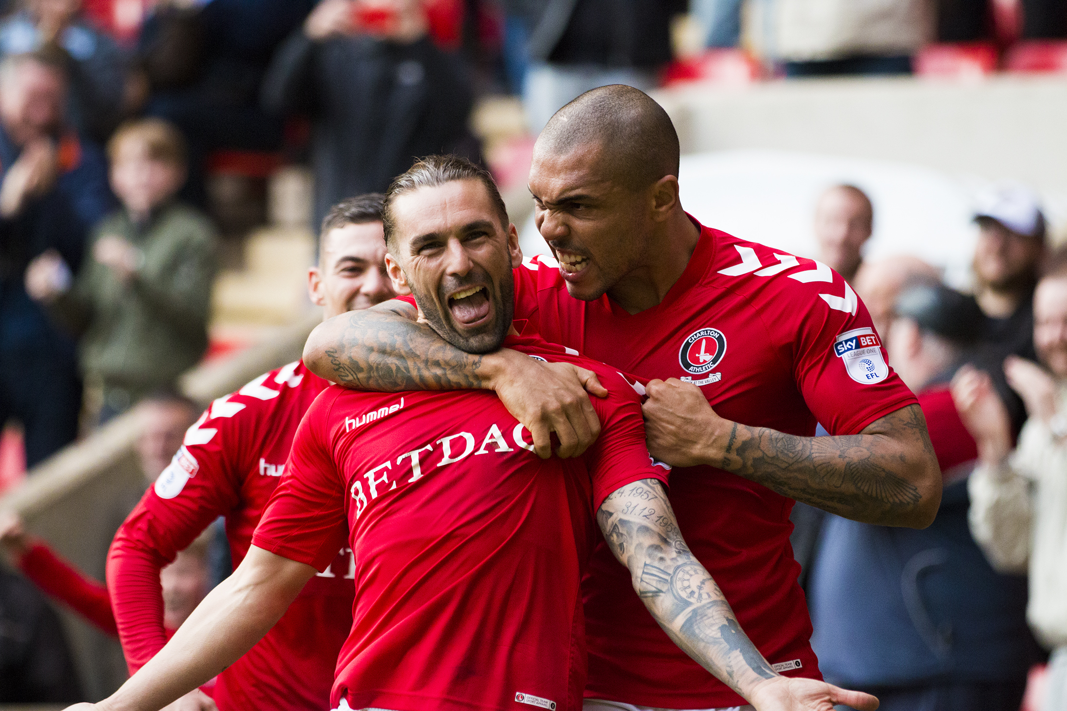 Ricky Holmes with Josh Magennis | Photo: Benjamin Peters Photography