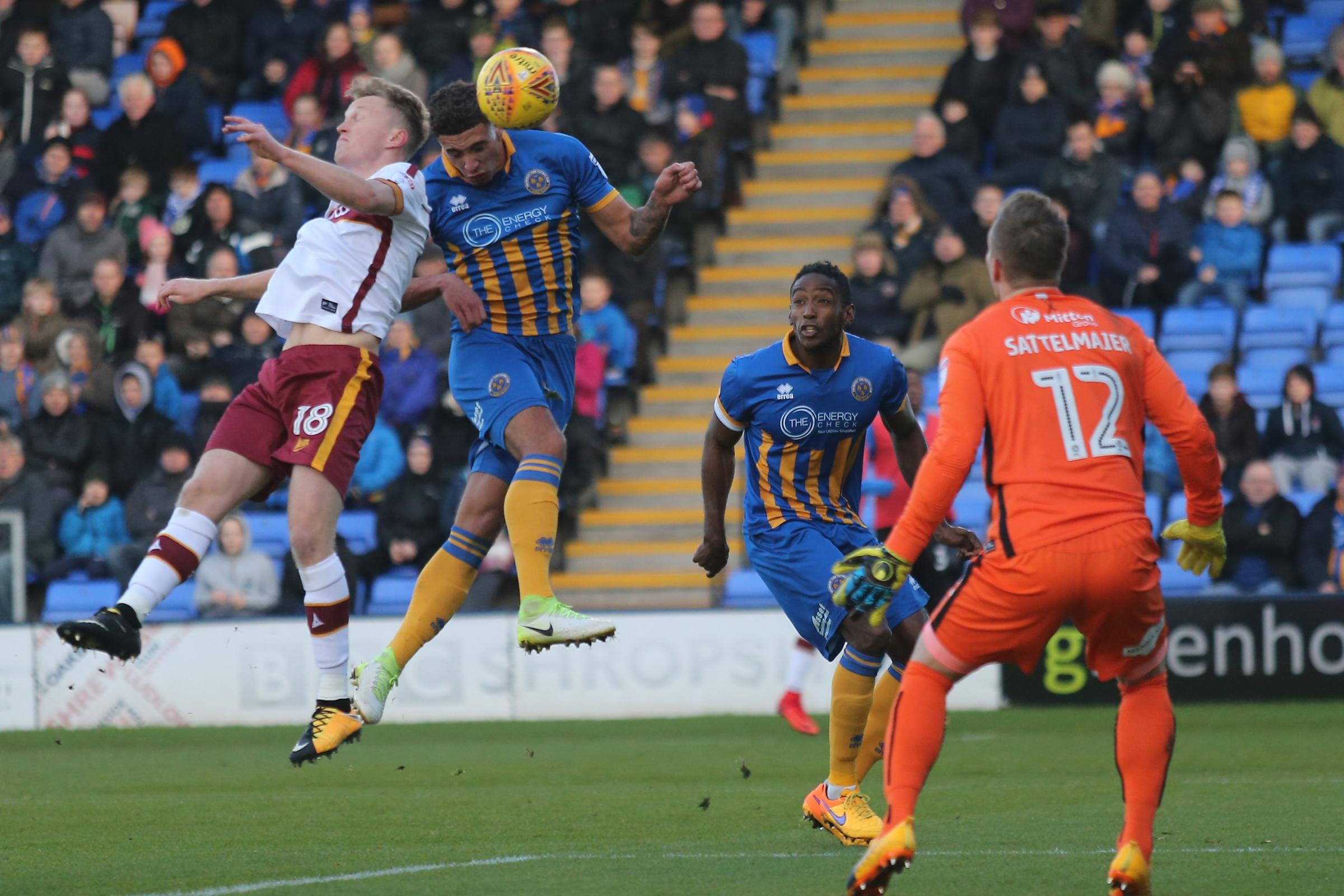 Ben Godfrey competes for a header during his time at Shrewsbury