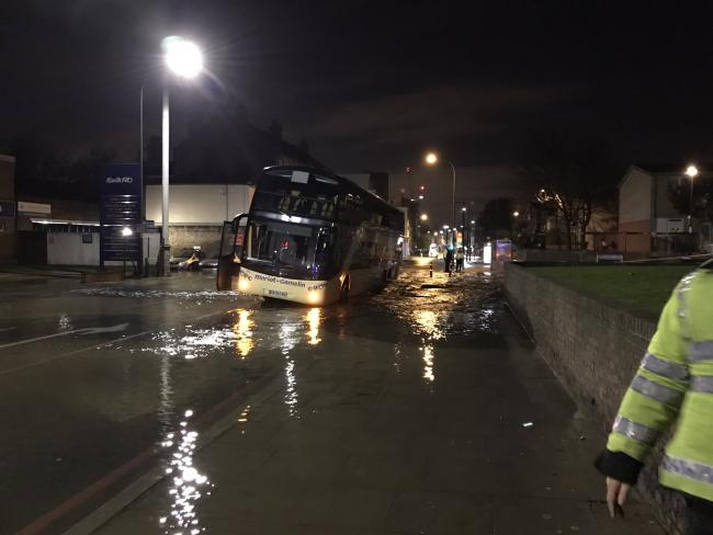 A coach got stuck in a hole caused by a burst water main in Lee High Road. Photo: Lewisham Central SNT