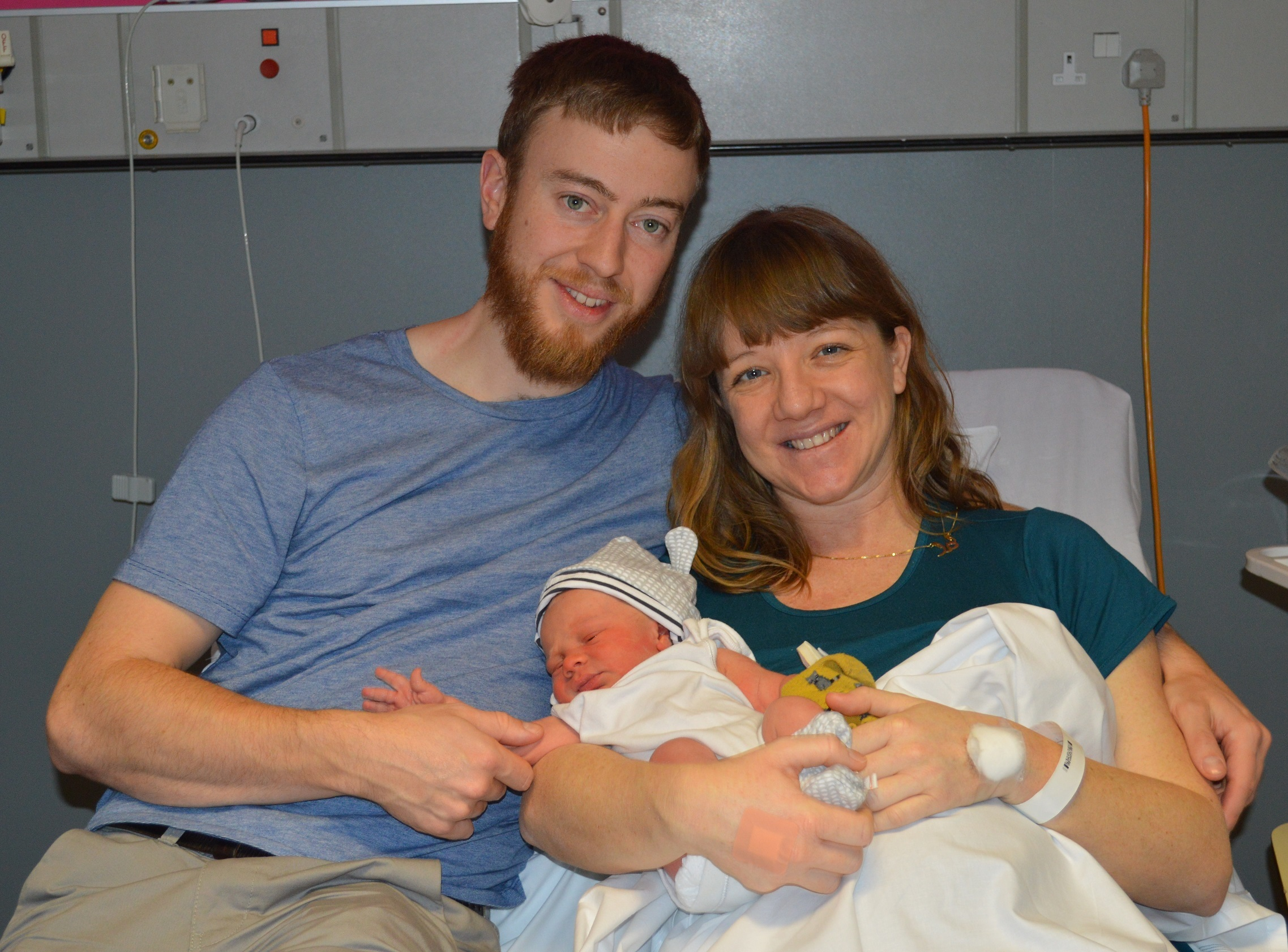 Parents Laura Allum and Daniel Peters with newborn baby Dylan