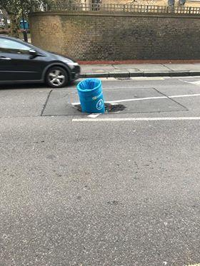 News Shopper: Catherine Jones caught this picture of a bin embedded in the middle of the road in Sanford Street, New Cross