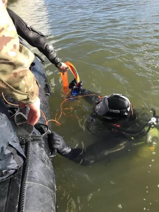 Royal Navy diver helps transport the massive unexploded World War 2 bomb