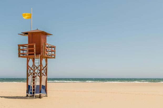 News Shopper: Wooden lifeguard tower on an empty beach. Photo by John Price