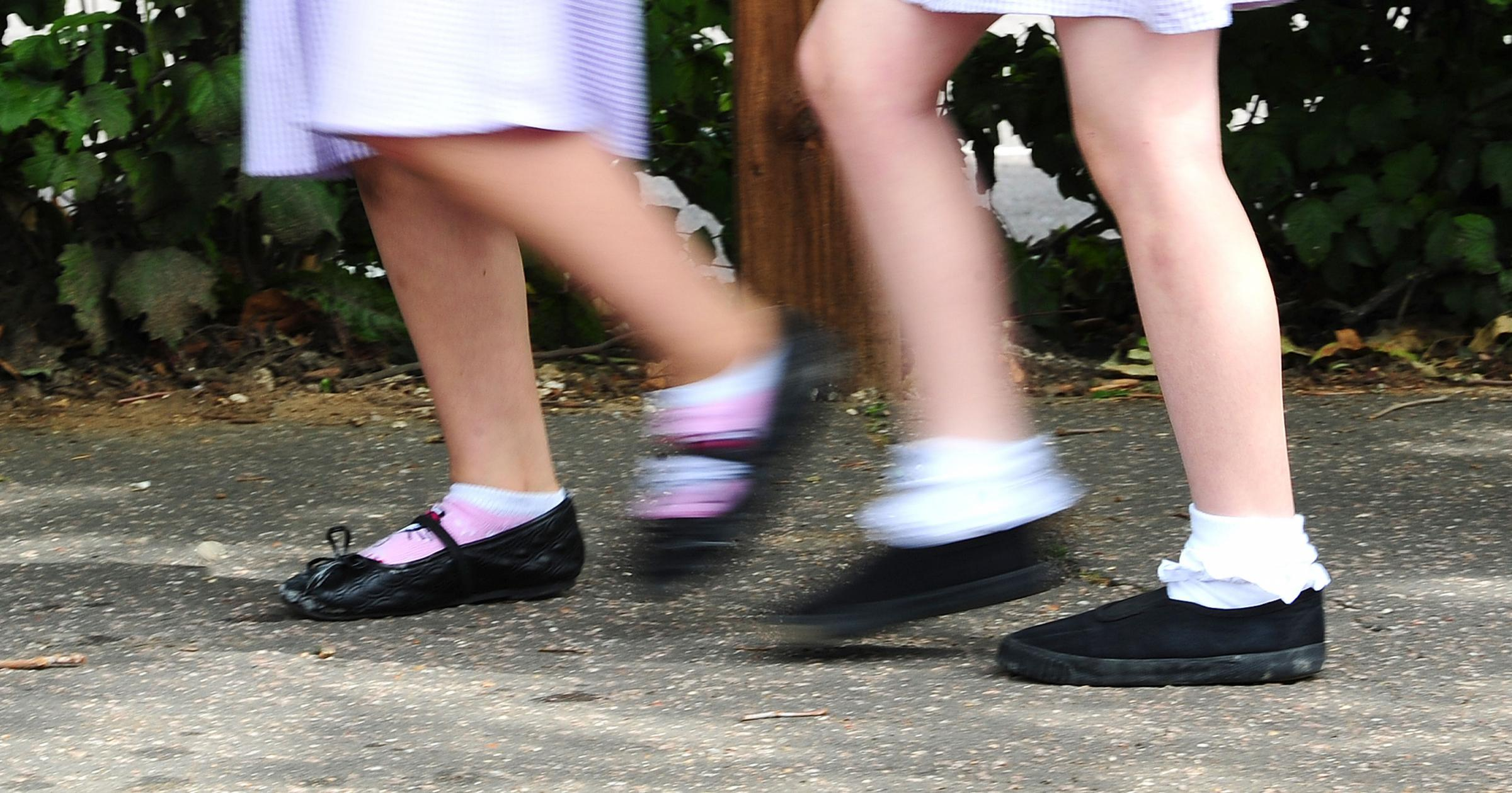 Embargoed to 0001 Wednesday August 15..File photo date 15/07/14 of two children.  Parents will spend an average £244.90 on kitting out each child to return to school next month, a survey suggests. PRESS ASSOCIATION Photo. Issue date: Wednesda