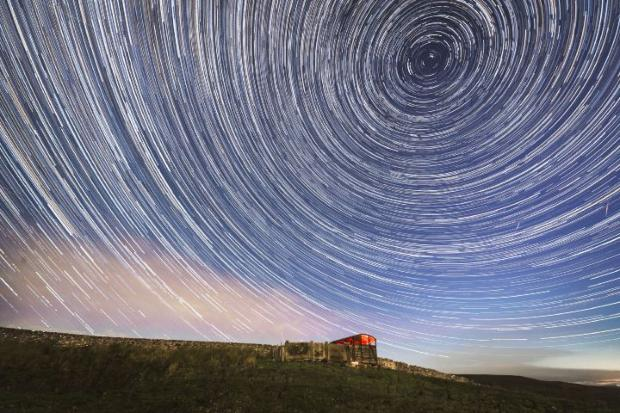 News Shopper: Meteors and star trails during the Perseid meteor shower seen from near Hawes in the Yorkshire Dales National Park, as the Earth flies through a cloud of cometary dust creating a spectacular display of celestial fireworks. PRESS ASSOCIATION Photo. Picture
