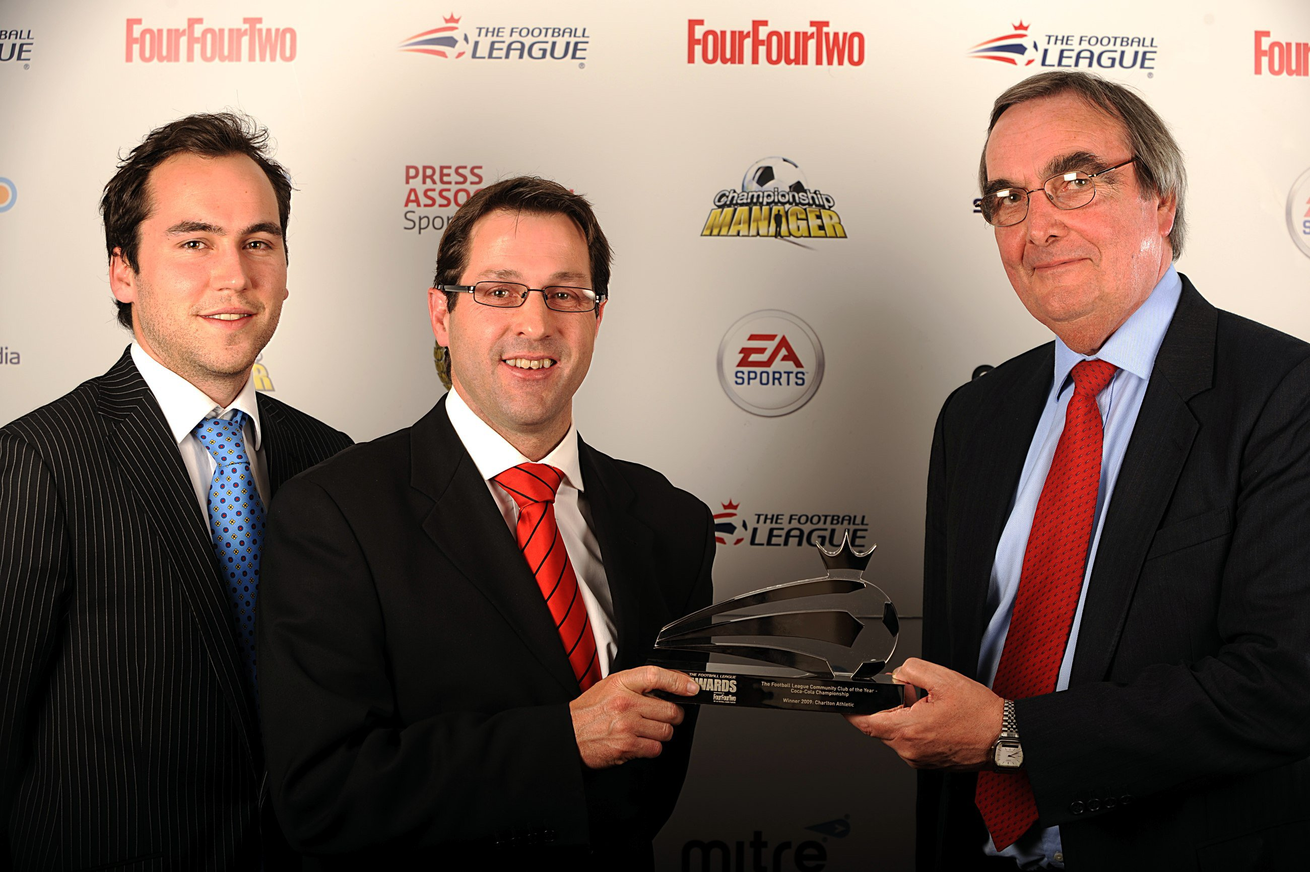 Jason Morgan (middle), chief executive of Charlton Athletic's Community Trust, receives the award on Sunday