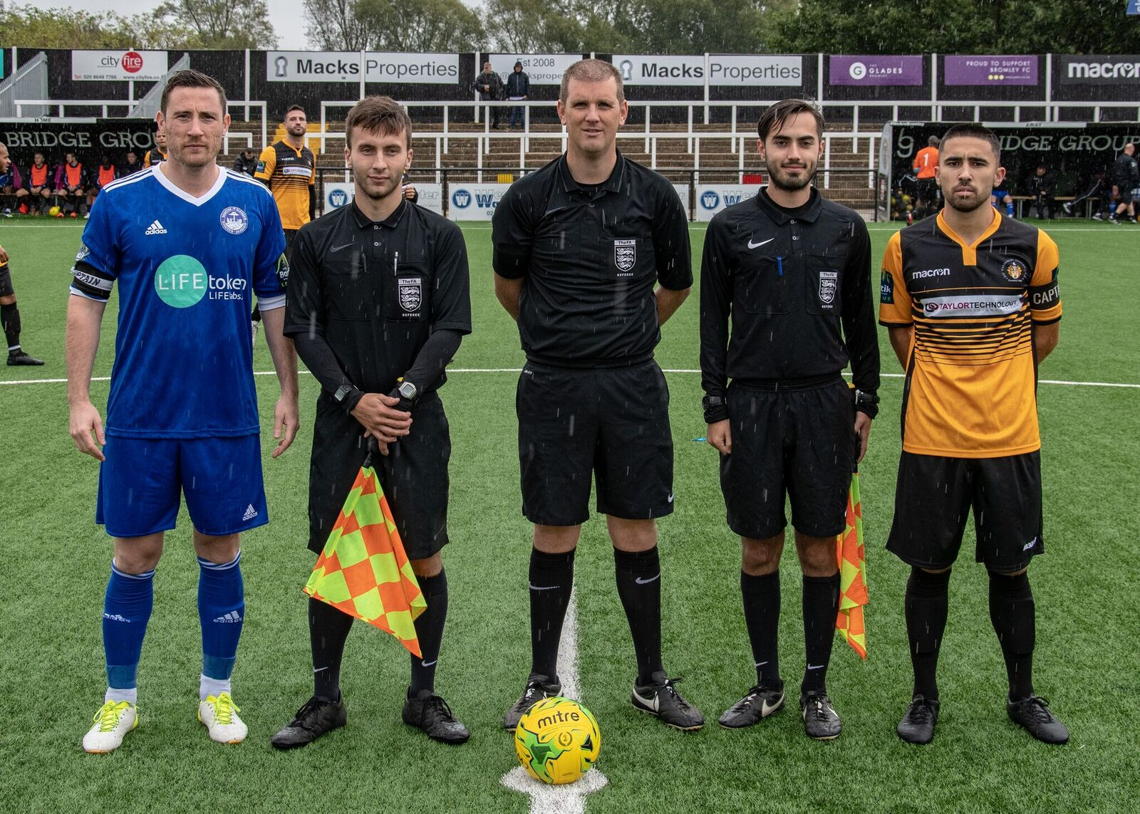 Captains Barney Williams and Chris Kinnear line up with officials before a dramatic afternoon. Pic Jon Hilliger