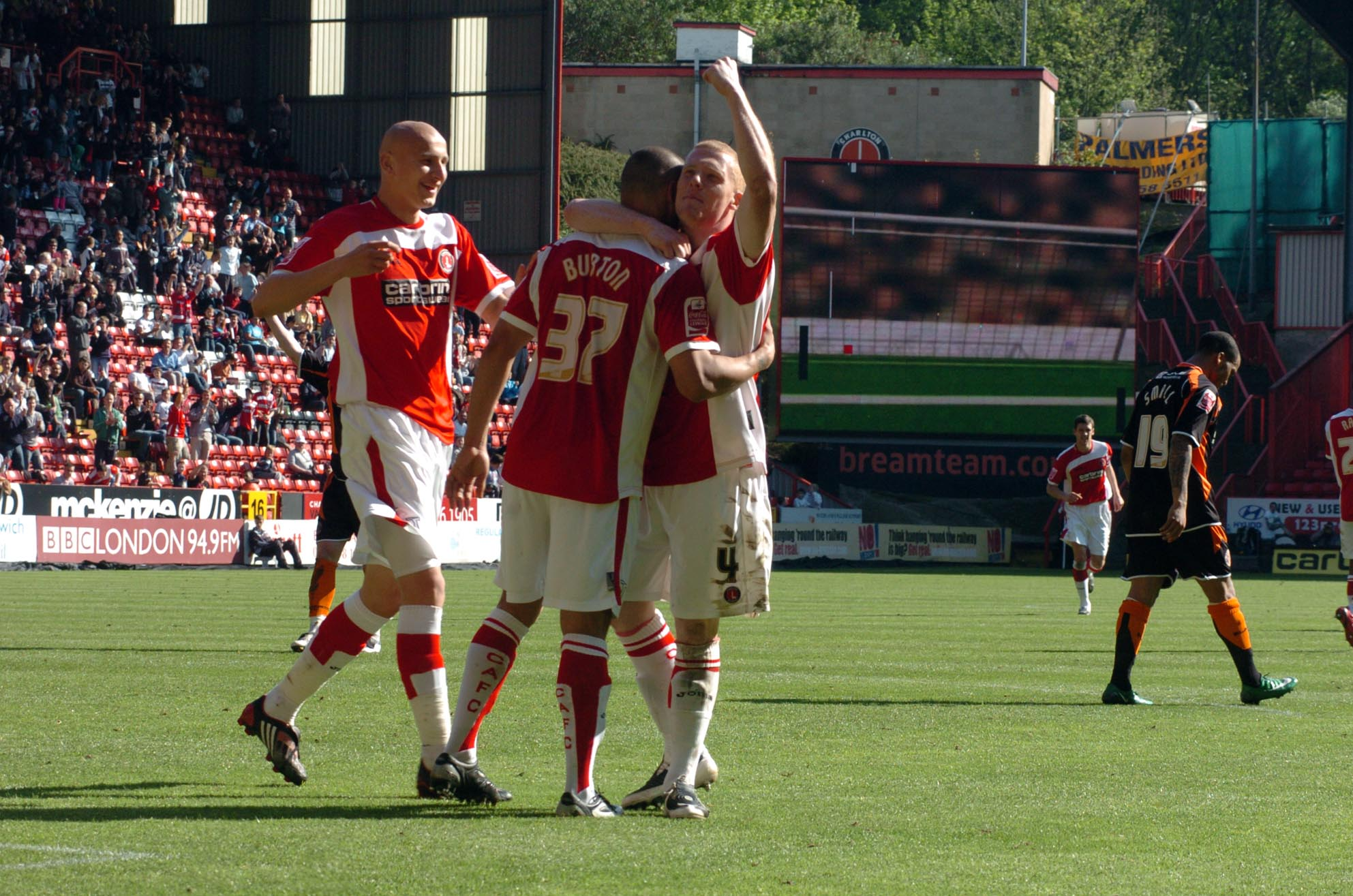 Deon Burton is congratulated by Jonjo Shelvey (left) and Nicky Bailey (right) after his opener