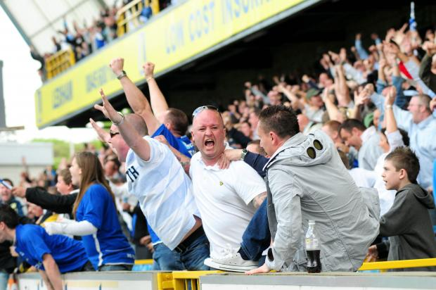 Millwall v Leeds games at The Den always havde added spice, as this picture of Lions fans celebrating the 2009 play-off win demonstrates
