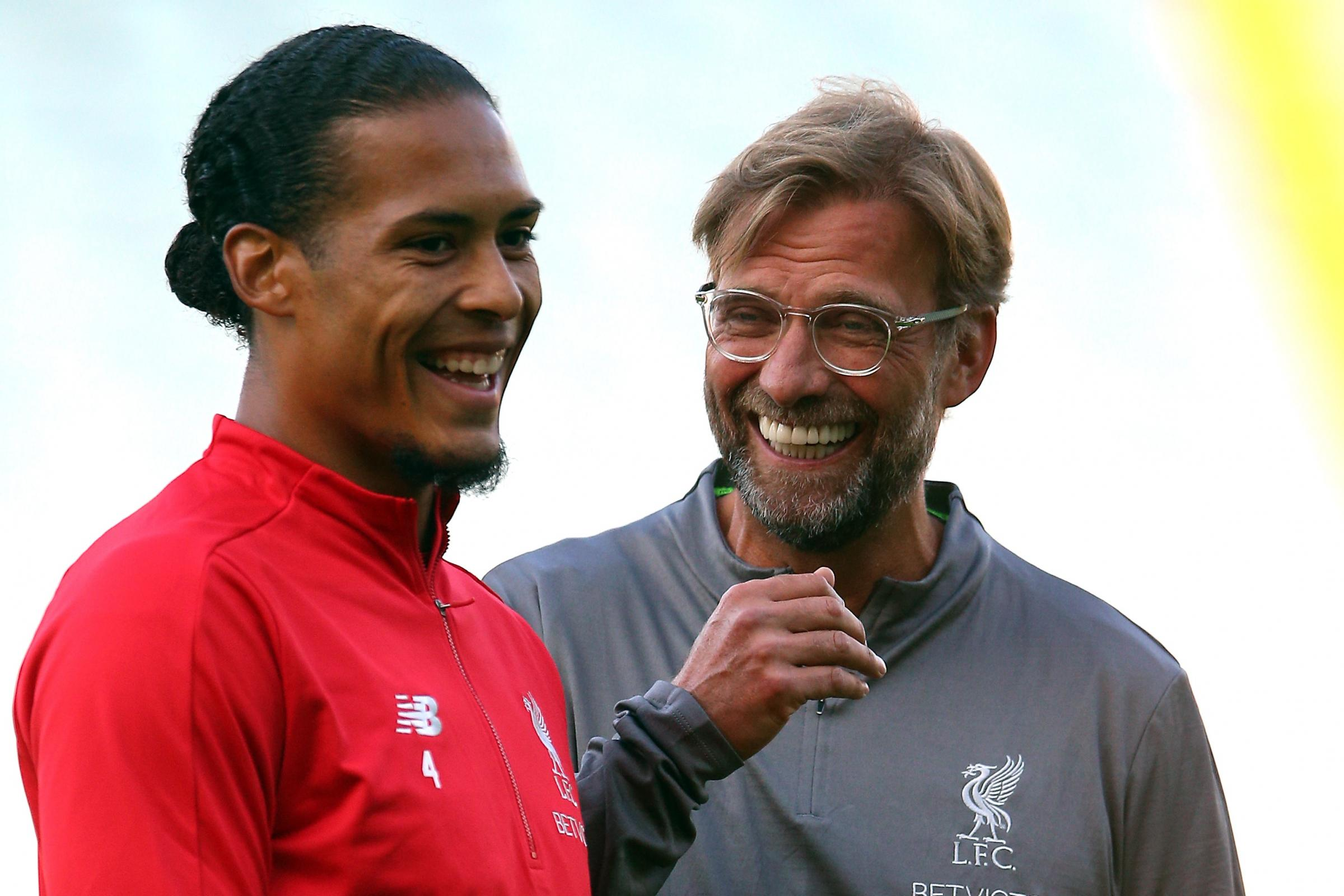 Virgil Van Dijk, left, has earned the praise of his manager Jurgen Klopp