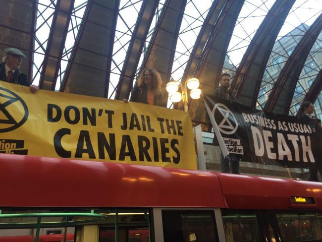Handout photo taken with permission from the Twitter feed of Extinction Rebellion of protesters who have climbed onto a DLR train at Canary Wharf station in London. Picture: Extinction Rebellion/PA Wire