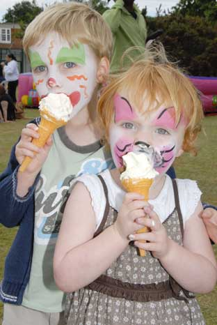 News Shopper: Four-year-old Jake Watson enjoys an ice cream with Scarlett Jeffries, two, at the Sunfayre