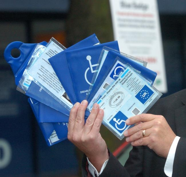 The council is warning people they will be prosecuted if they use a family member's blue badge when they shouldn't