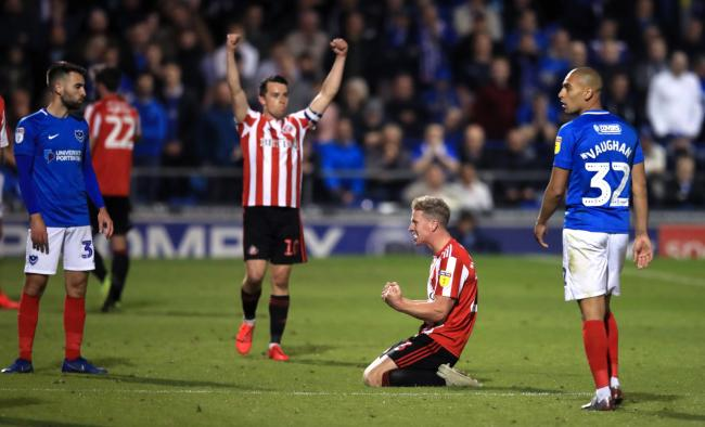 Sunderland players celebrate as Portsmouth players stand dejected at the final whistle of the Sky Bet League One Play-off, Semi Final, Second Leg match at Fratton Park, Portsmouth.
