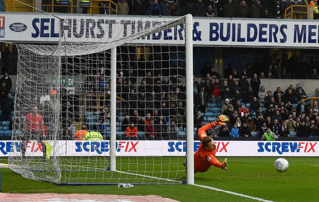 Millwall's David Martin dives to stop a penalty from West Bromwich Albion's Jay Rodriguez (not pictured) during the Sky Bet Championship match at The Den, London.